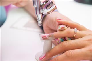 Closeup photo of women hand and manicure