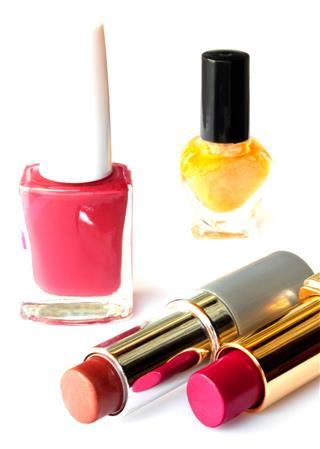 Nail polish and lipstick isolated on white background
