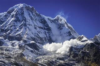 Avalanche Thundering Down Mountain Peak