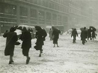 People In City Walking In Blizzard