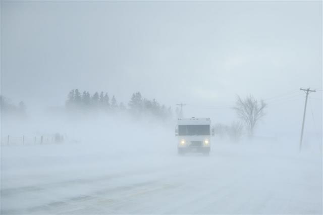 Truck Driving Through A Blizzard