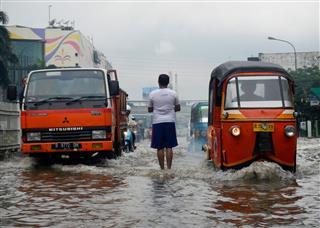 Vehicles Across Flooding Street Jakarta