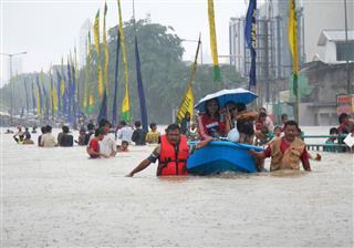Jakarta Resident Across The Flooding Street