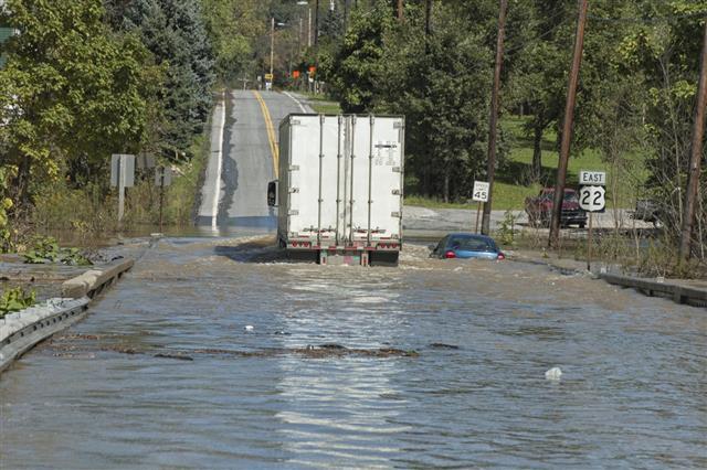 Truck Going Through Deep Flood Water