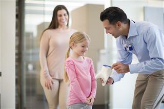 Dentist Teaching A Little Girl