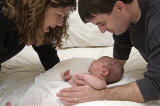 Parents Taking Care Of Newborn