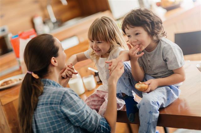 Mother With Children Having Breakfast