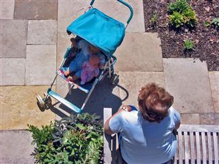 Dolls In A Stroller