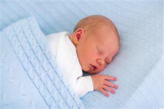 Newborn Baby Boy On A Blanket