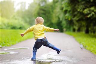 Little Boy Wearing Rain Boots