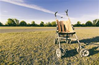 Empty Orange Baby Stroller