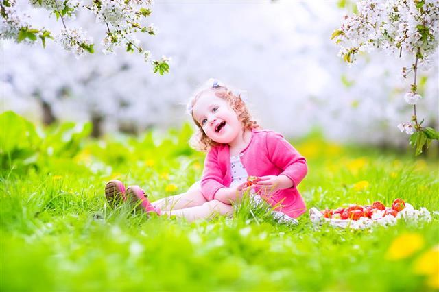 Toddler Girl Eating Strawberry