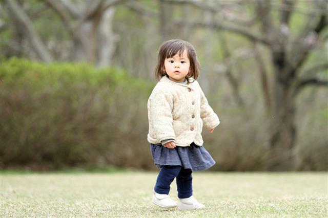 Girl Walking On Grass