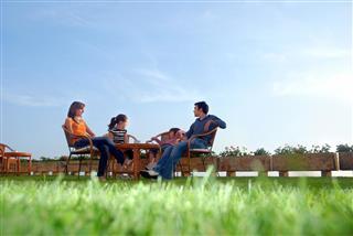Family Sitting in Garden