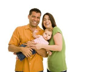 Smiling Couple Holding Infant Girl