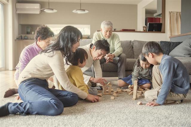 Adults building blocks