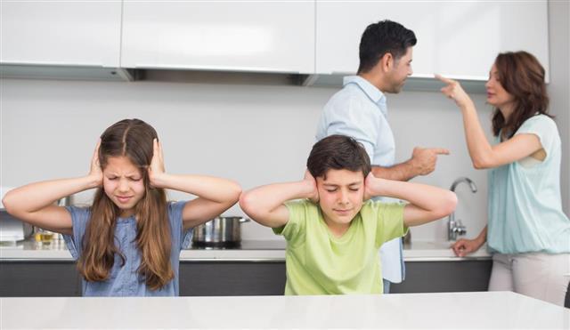 Sad young kids while parent quarreling