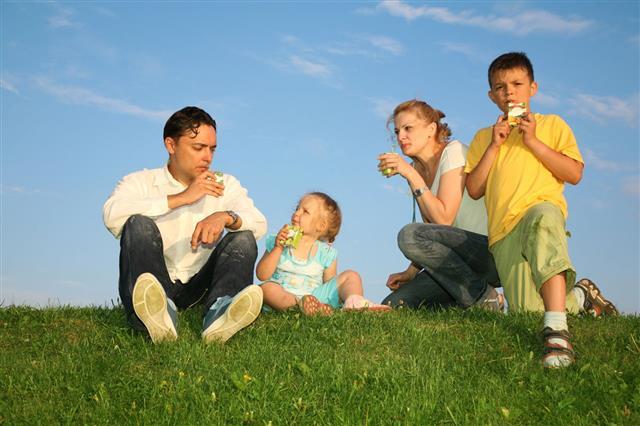 Drinking Family Grass Sky