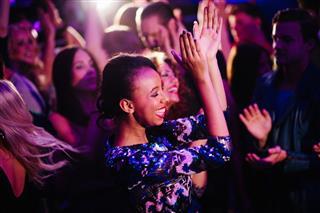 Girl Enjoys Dancing In Nigh Club