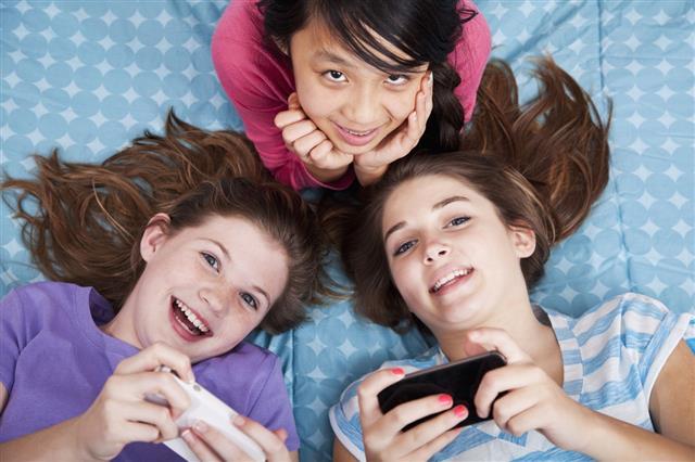 Girls Texting At Slumber Party