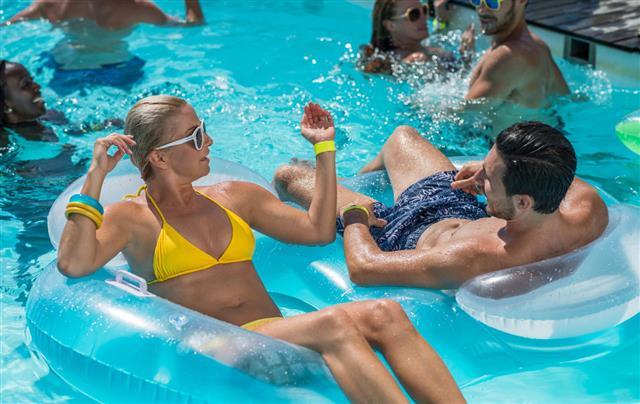 Friends Enjoying Summer in swimming pool