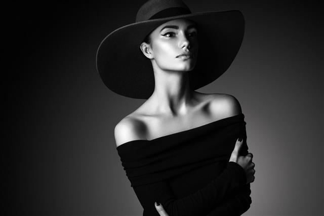 Young Beautiful Woman Wearing Black Hat