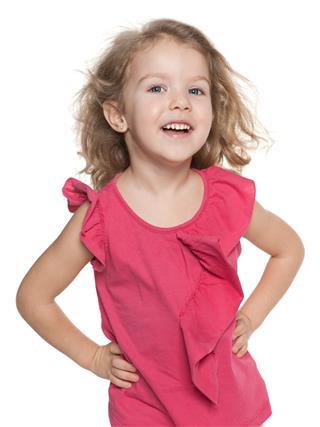Laughing Preschool Girl Against The White