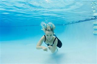 Underwater Swimming Of Retired Woman