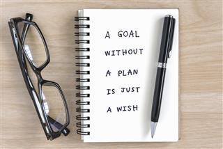Motivational handwriting on a notebook