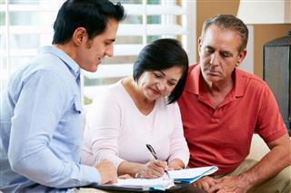 Financial Advisor Talking To Couple