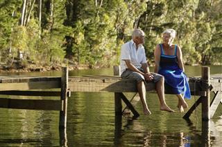 Senior Couple Sitting At Lake