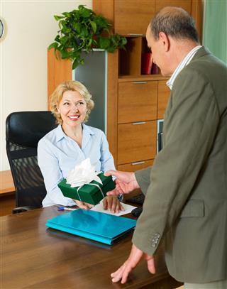 Office Manager Congratulating Secretary