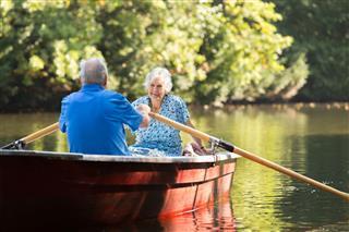 Happy Senior Couple At Lake
