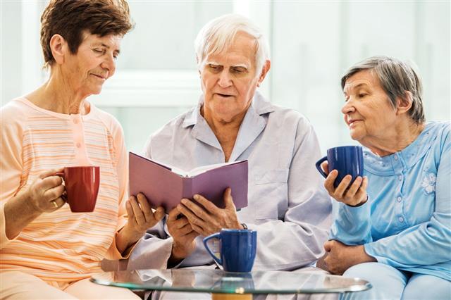 Senior People Enjoying While Reading Book