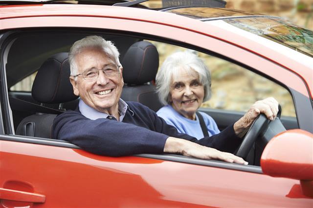 Smiling Senior Couple In Car