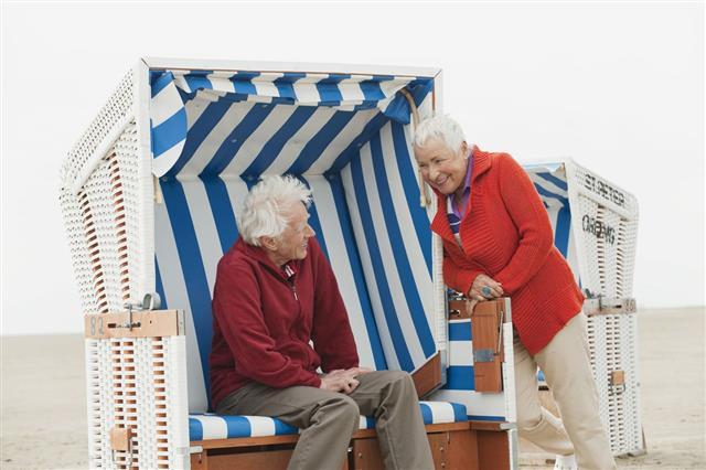Senior Couple Man Resting On Beach
