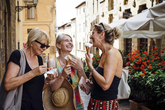 Female Friends Enjoying Italian Ice Cream