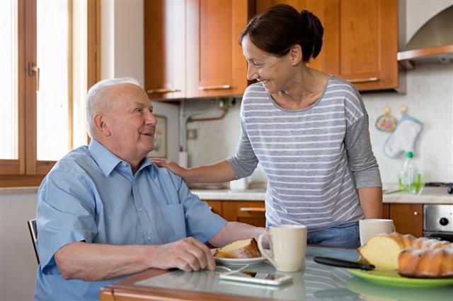 Female Caregiver Helping Senior Man