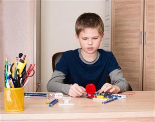 Teen Boy Doing School Electronic Project