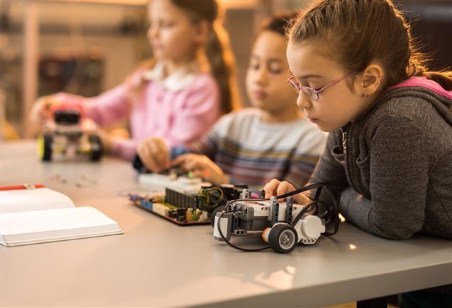 Little Engineers Working On Innovative Robots