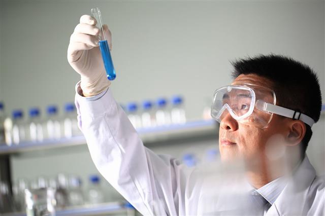 Scientist Holding Chemical Test Tube