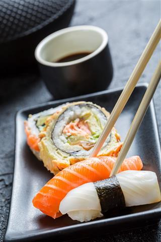 Sushi In A Black Ceramic Plate