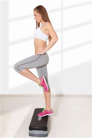 Young Woman Doing Step Aerobics