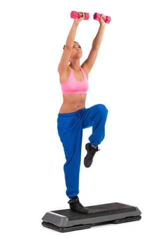 Female Exercise On Aerobic Step