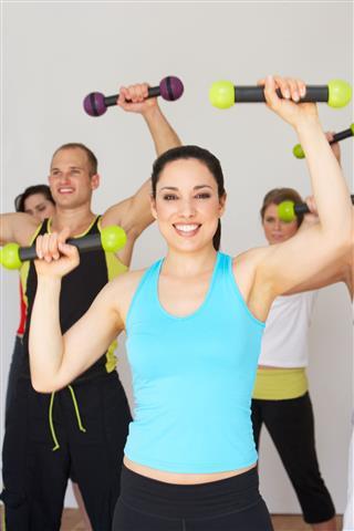 People Exercising In Dance Studio