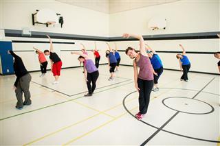 Women Doing Aerobics In Gym