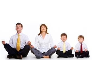 Meditating family