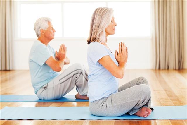 Senior Couple Performing Yoga