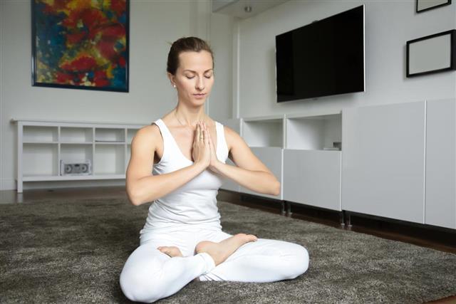 Woman sitting in Lotus exercise