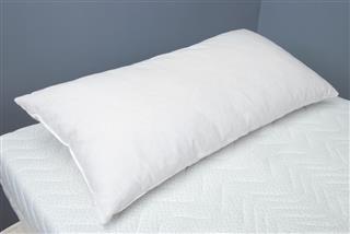 Pillow with RHOMBO FILL on mattress